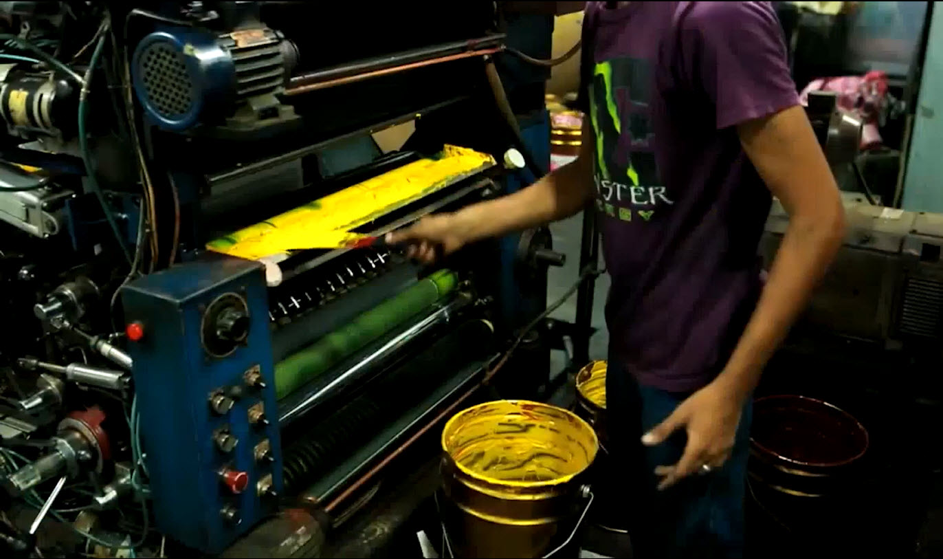 mixing citronella with ink on a newspaper press